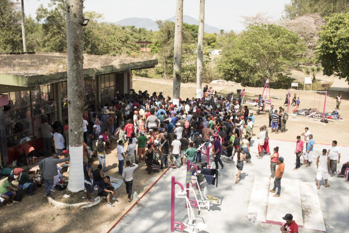Central American refugees and asylum seekers, led by the non-profit humanitarian organisation Pueblo Sin Fronteras (People Without Borders), stand in line to meet with National Institute of Migration officials in the town of Matias Romero, Oaxaca sta