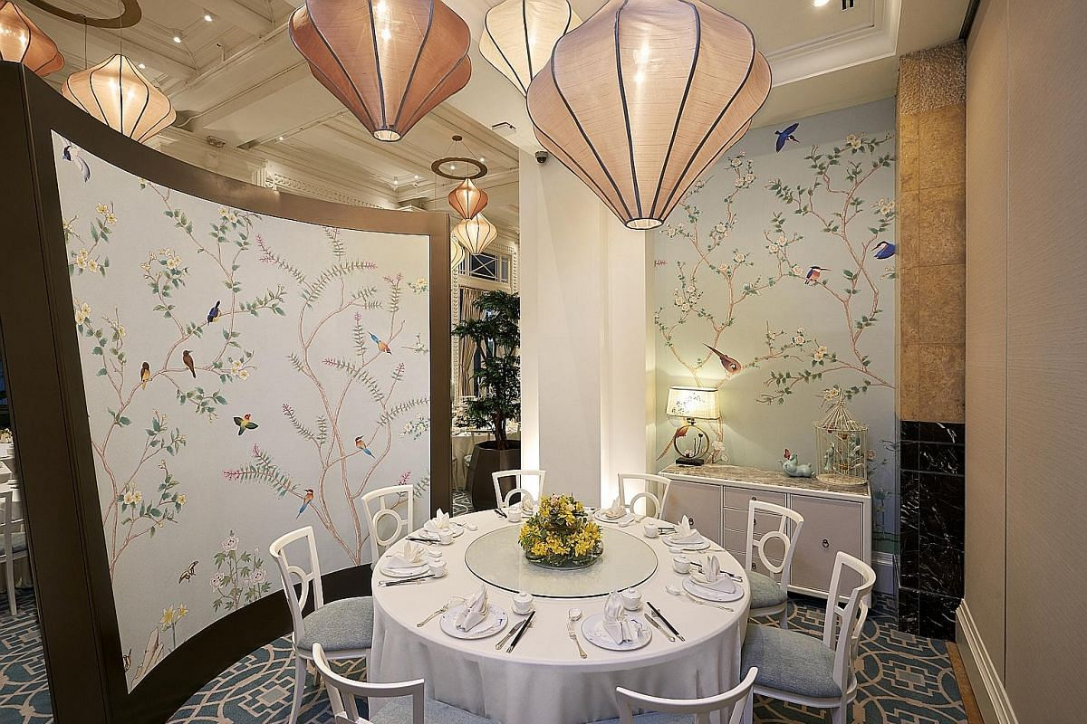 Asian touches at Jade restaurant (above) include the chinoiserie-style wallpaper on dividing screens (above left).