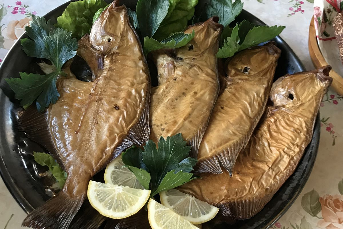 Homemade hot-smoked Baltic flounder at Dieninas, a fishing cottage Art Nouveau in Berzciems.