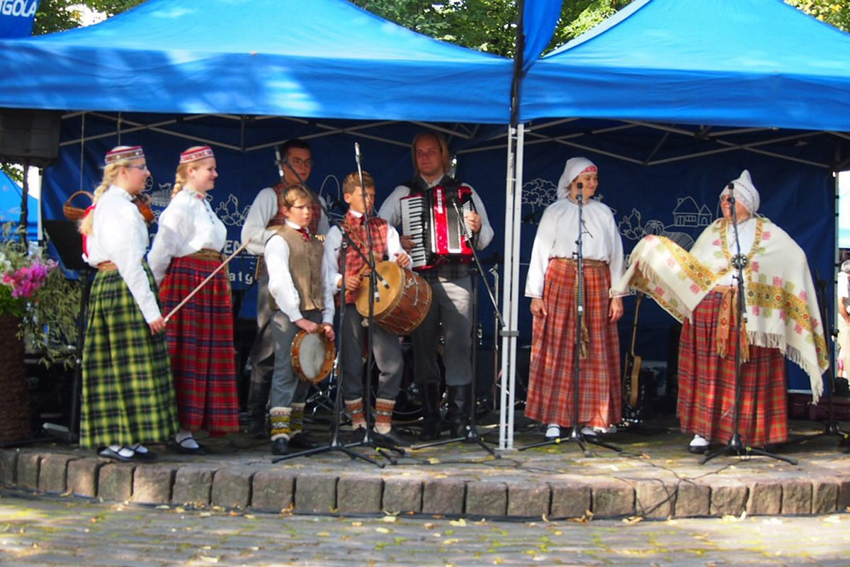 A Latvian folk song and dance troupe performing at a summer market in Riga.