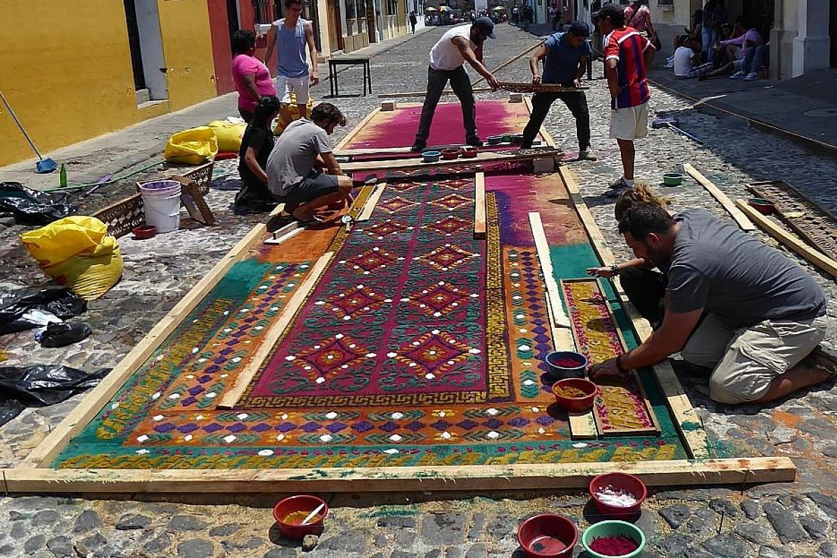"""During the week leading up to Easter, the streets of Antigua are lined with """"carpets"""" made of coloured sawdust, to be trampled on by processions carrying replicas of various stations of the cross."""