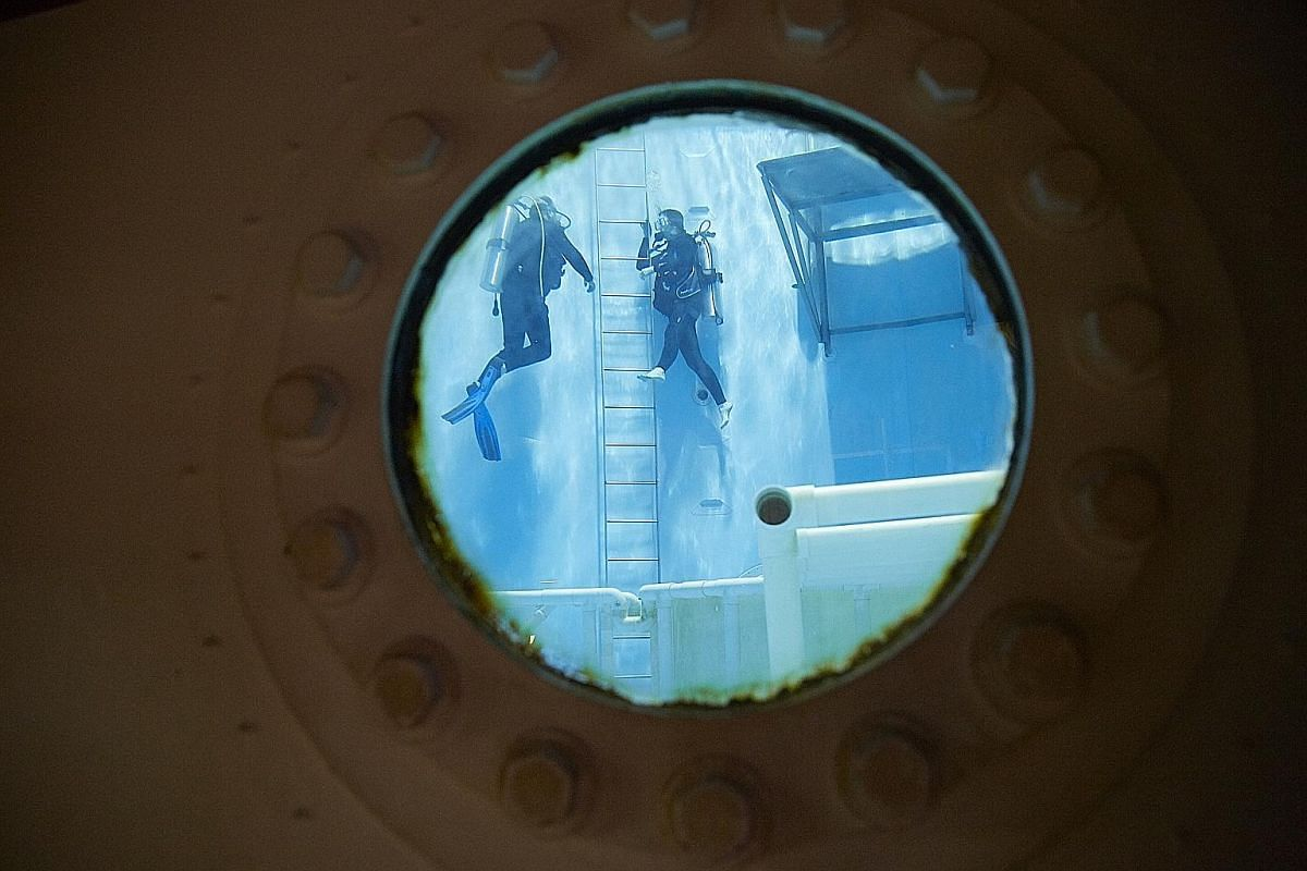Above: Space Camp has interactive space missions for children and adults. Left: A guided scuba dive in a 7m-deep pool.