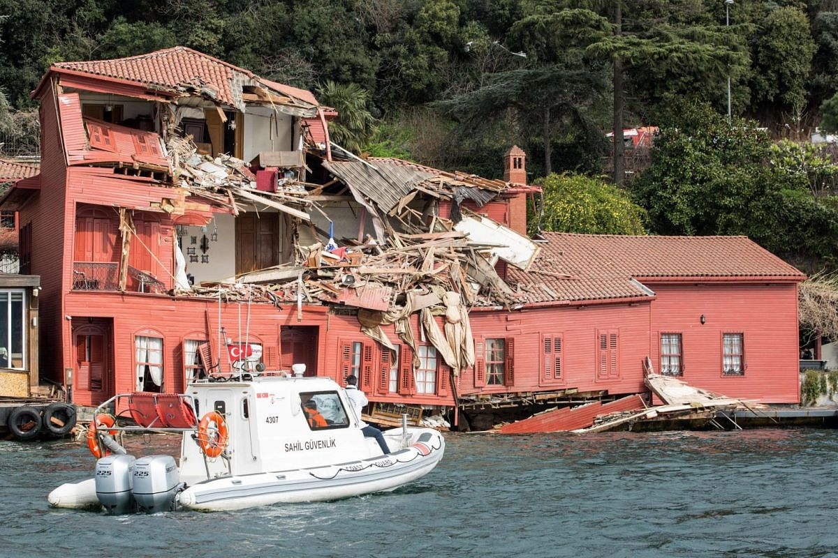 A coast guard boat steers towards a historic mansion on the shores of Istanbul's Bosphorus after a tanker accident on April 7, 2018. A cargo vessel crossing through the Bosphorus in Istanbul on April 7 crashed into a historic waterside mansion due to