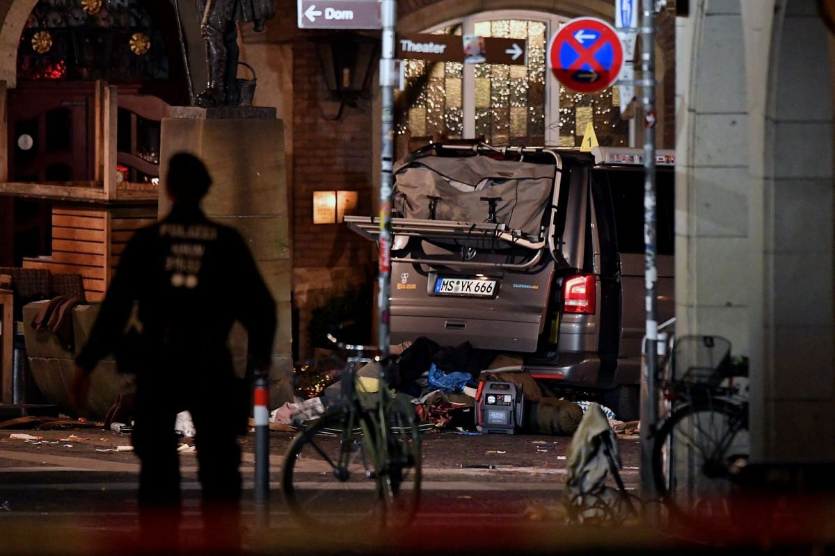 A view of crime scene with the vehicle after an attack in the inner city of Muenster, Germany, April 8, 2018. According to the police, a man drove a van into a crowd of people in the city of Muenster, western Germany, and then killed himself on April