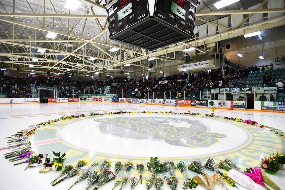 Flowers lie on the ice as people gather for a vigil at the Elgar Petersen Arena, home of the Humboldt Broncos, to honour the victims of a fatal bus accident in Humboldt, Canada, April 8, 2018. PHOTO: AFP