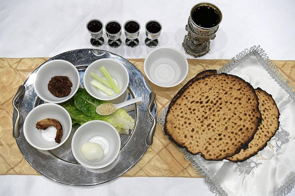 Besides the Seder plate, there is a bowl of salt water, four cups of grape juice or wine, three pieces of matzahs (unleavened bread), and a separate cup of wine for Elijah on the table. On the Seder plate are a chicken neck representing the lamb sacr