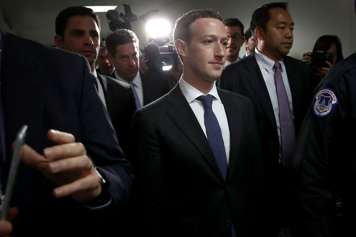 Facebook CEO Mark Zuckerberg (C) leaves the office of Sen. Dianne Feinstein (D-CA) after meeting with Feinstein on Capitol Hill on April 9, 2018 in Washington, DC. Zuckerberg is meeting with individual senators in advance of tomorrow's scheduled hear