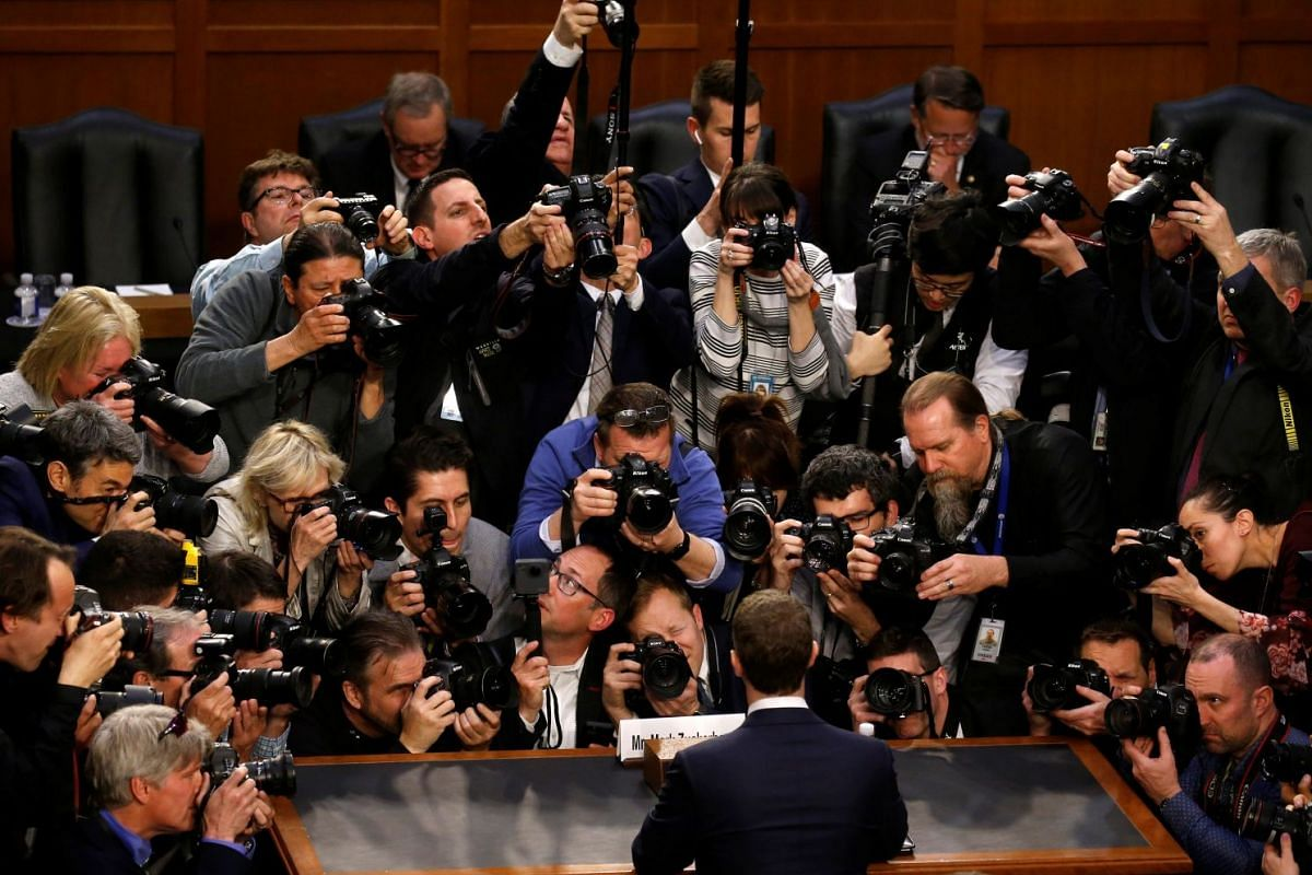 Facebook CEO Mark Zuckerberg is surrounded by members of the media as he arrives to testify before a Senate Judiciary and Commerce Committees joint hearing regarding the company's use and protection of user data, on Capitol Hill in Washington, U.S.