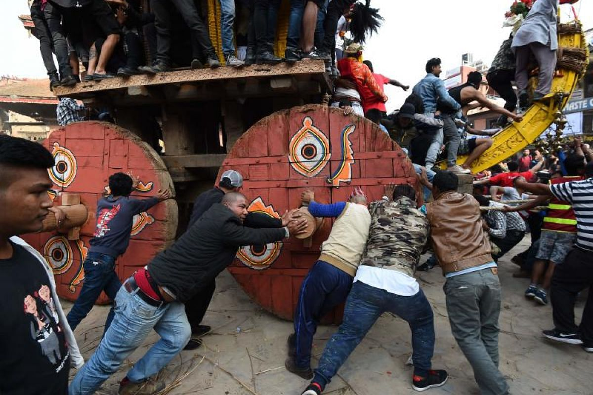 Nepali Hindu devotees pull a wooden chariot through crowds during the Bisket Jatra festival, held to mark the Nepalese New Year in Bhaktapur, Nepal, on April 10, 2018.