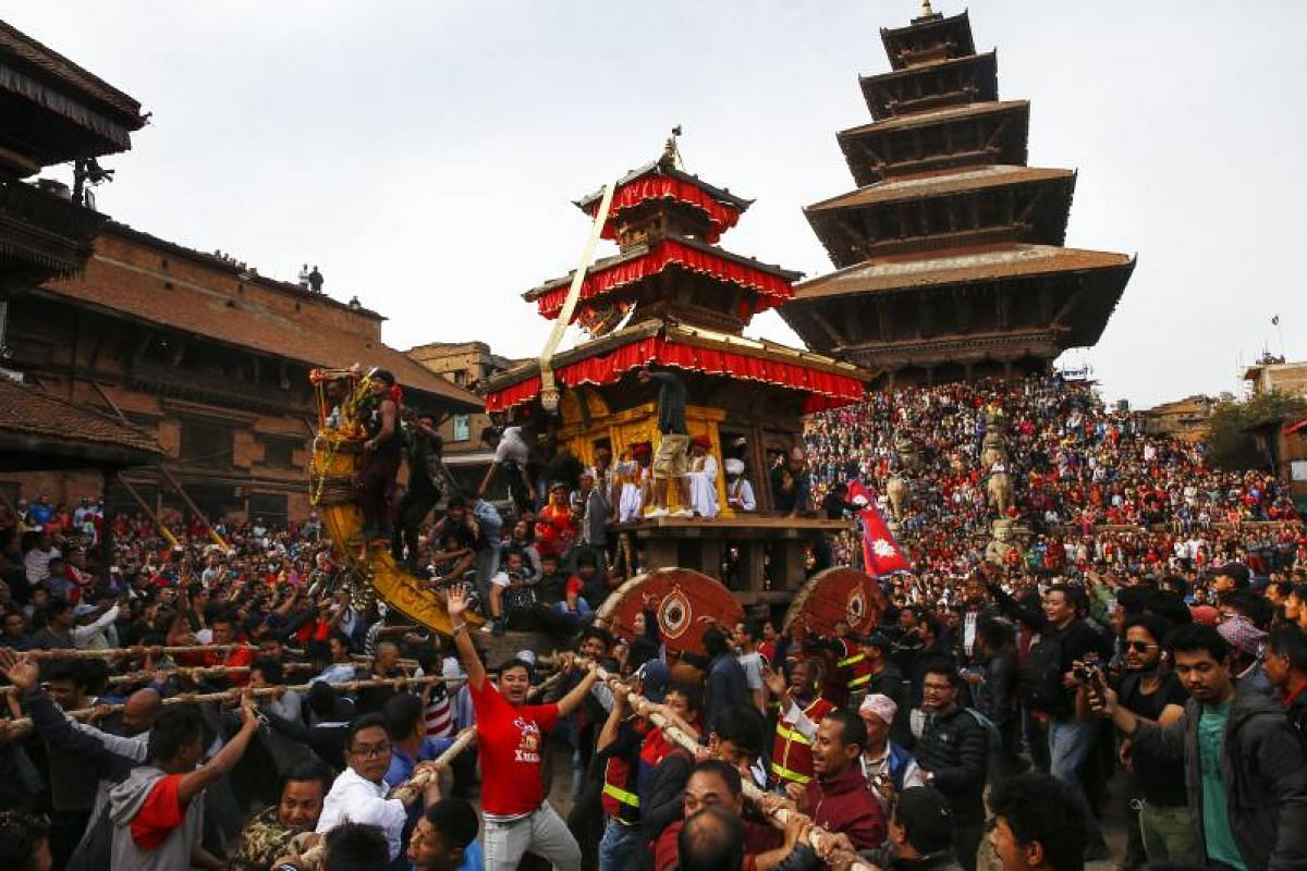 Nepalese devotees pull a wooden chariot with Goddess Bhairab, the god of power inside, as they take part in the traditional Bisket Jatra festival, ahead of the Nepali New Year celebrations in Bhaktapur, near Kathmandu, Nepal, on April 10, 2018.