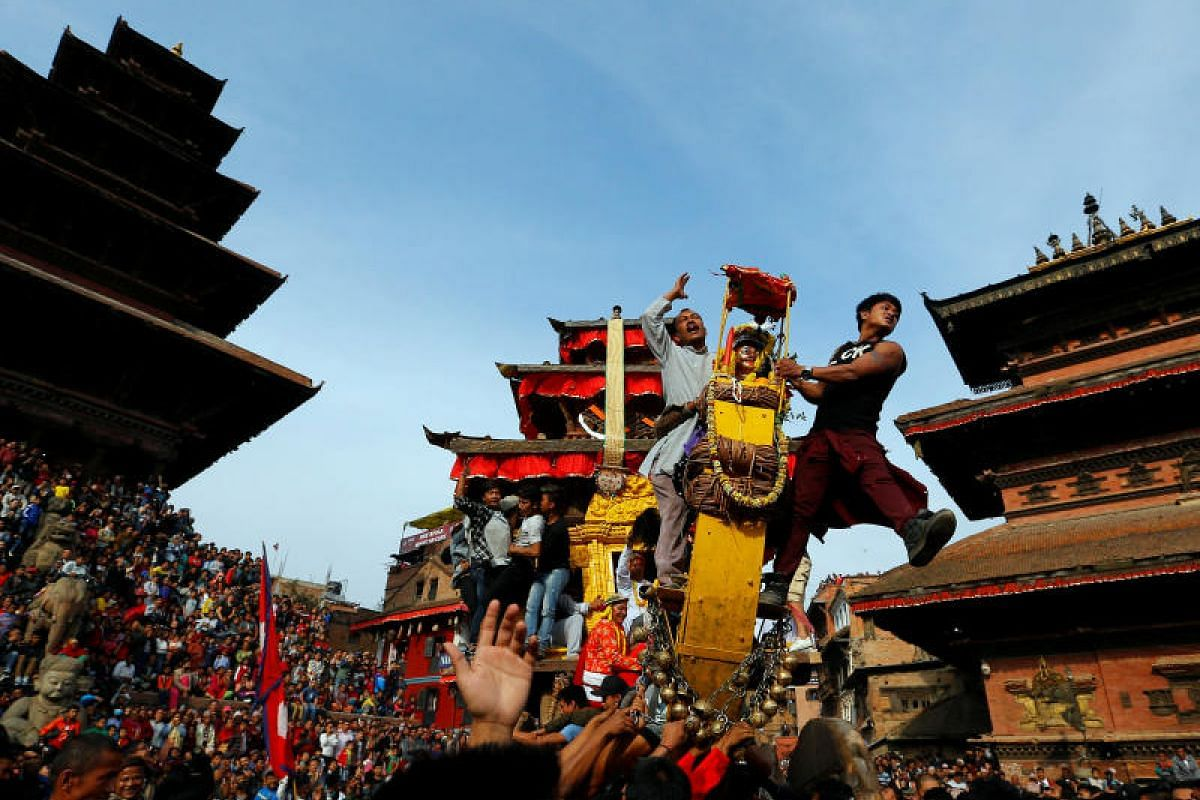 The chariot of God Bhairab is pulled through the city centre during the Bisket Jatra festival in Bhaktapur, Nepal, on April 10, 2018.