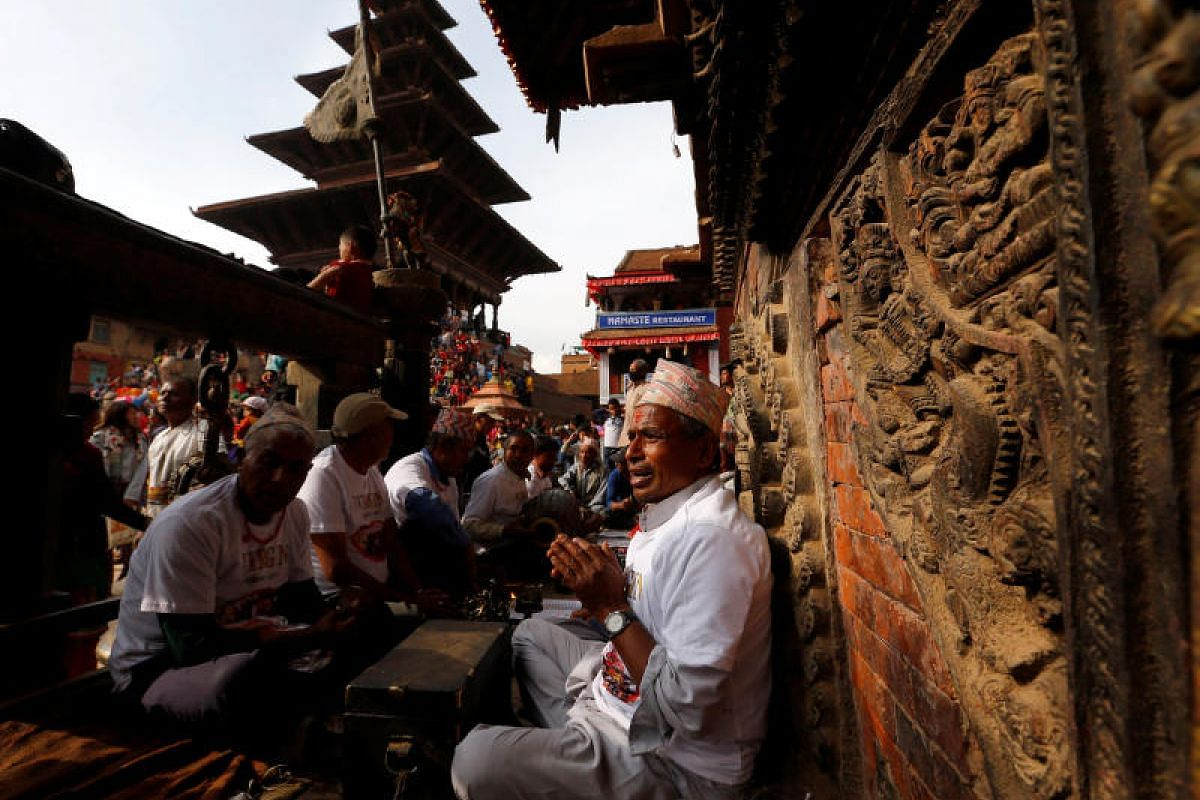 A devotee offers a prayer during the Bisket Jatra festival in Bhaktapur, Nepal, on April 10, 2018.