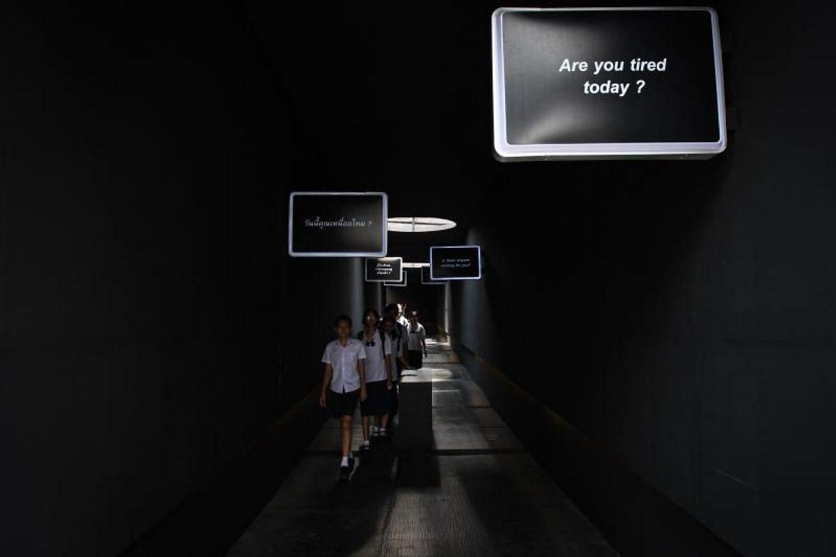 Thai teenagers arrive at the Kid Mai Death Awareness Cafe in Bangkok.