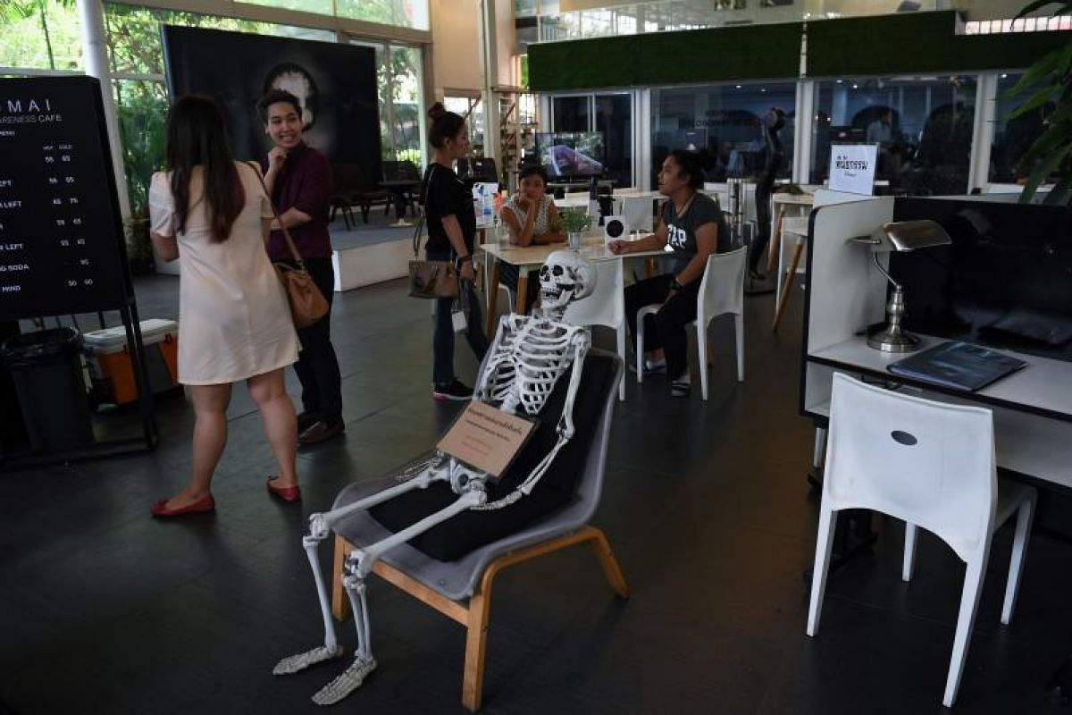 A skeleton on a chair at the Kid Mai Death Awareness Cafe, an exhibition space built to educate the public about death and Buddhism, in Bangkok.