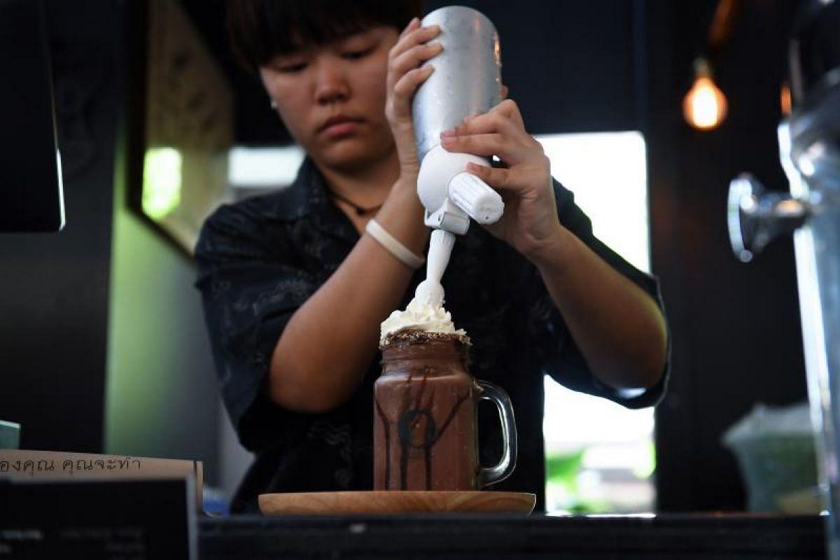 A barista prepares a chocolate milkshake called Death, at the Kid Mai Death Awareness Cafe in Bangkok.