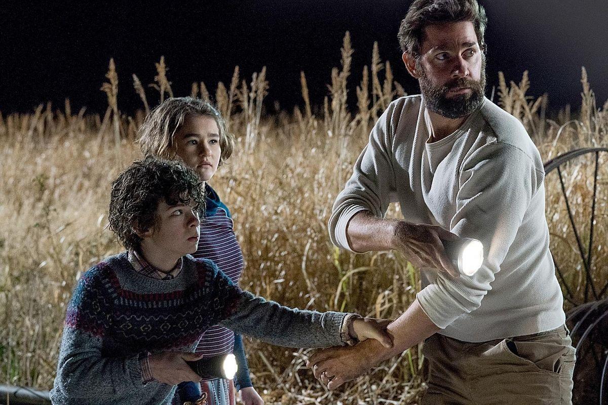 Lee Abbott (John Krasinski) keeps his children (Noah Jupe and Millicent Simmonds) safe from monsters in A Quiet Place.