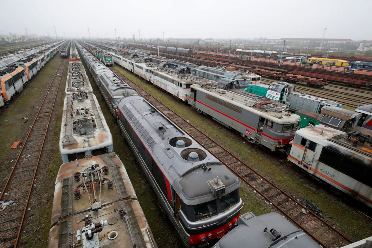 """A view shows several hundred train locomotives, passenger, and freight railway cars of different generations that are parked at a so-called """"train cemetery"""" inside a marshalling yard in Sotteville-Les-Rouen, near Rouen, France, April 12, 2018. PHOTO:"""