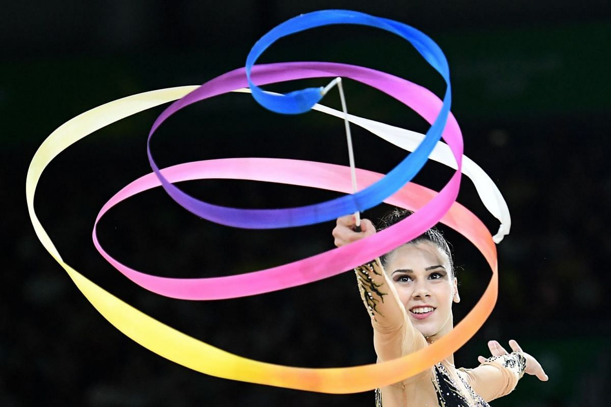Cyprus' Diamanto Evripidou competes in the ribbon event of the rhythmic gymnastics individual all-around final during the 2018 Gold Coast Commonwealth Games at the Coomera Indoor Sports Centre on the Gold Coast on April 12, 2018. PHOTO: AFP