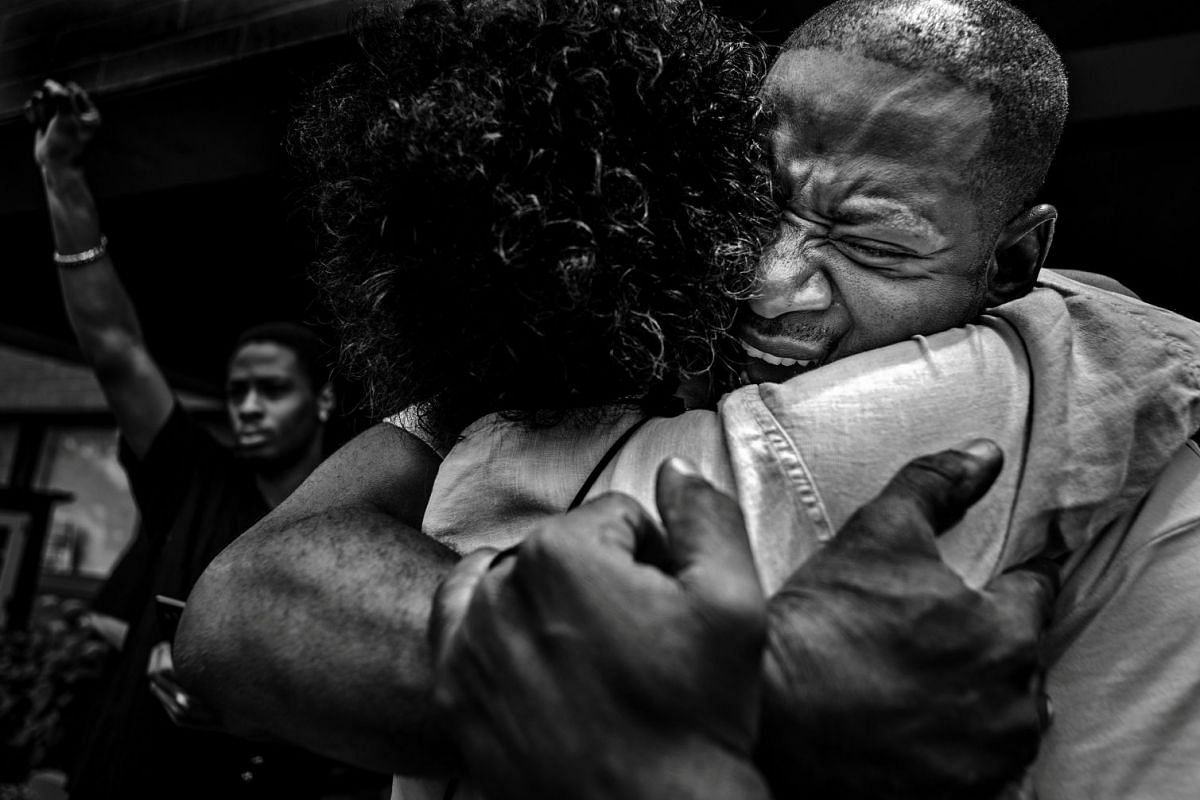 The second-prize winner of World Press Photo 2018 for General News Singles, taken by Richard Tsong-Taatarii on June 18, 2017, shows John Thompson being embraced after speaking out at a memorial rally for his close friend Philando Castile, two days af