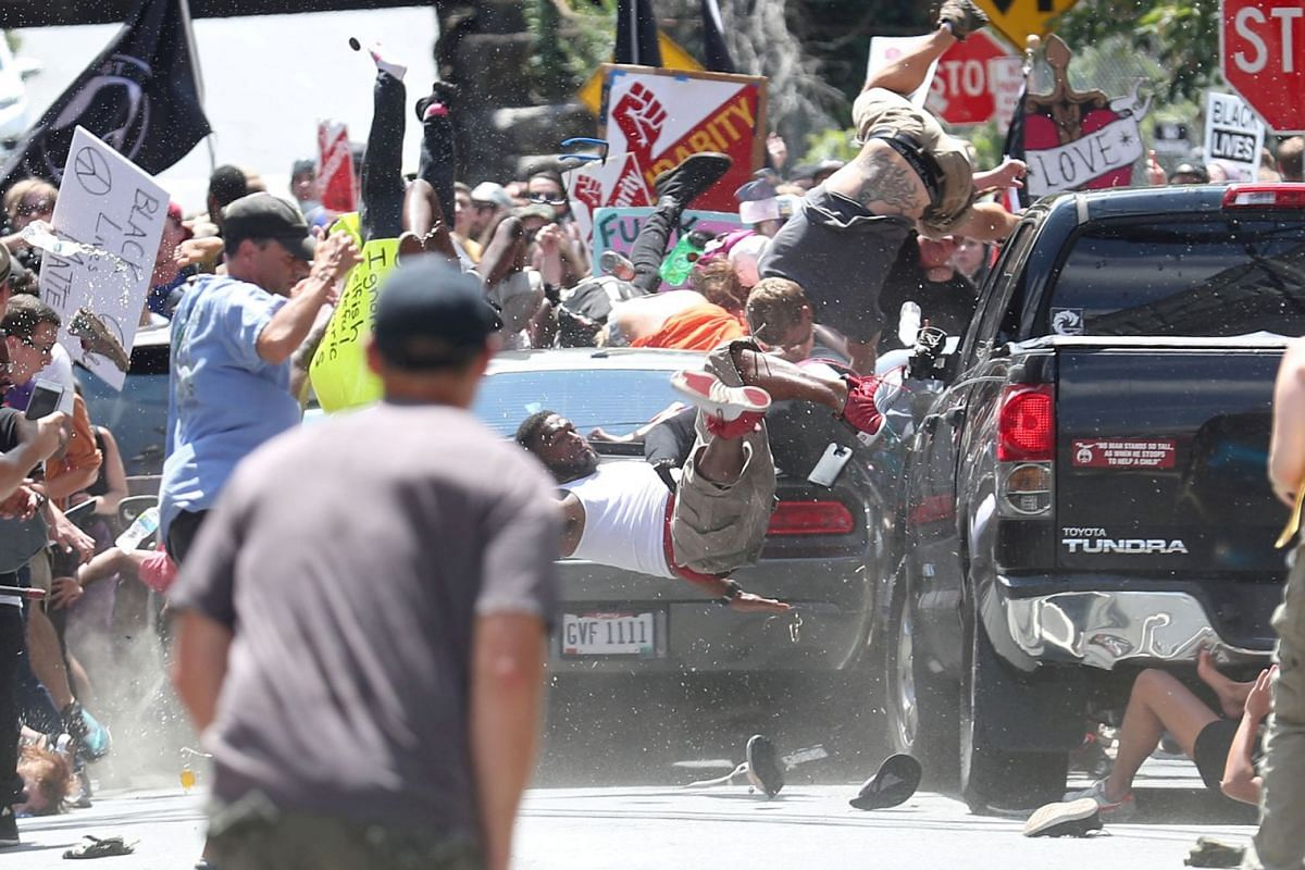 The second-prize winner of World Press Photo 2018 for Spot News Singles, taken by Ryan M. Kelly on Aug 12, 2017, shows people being thrown into the air as a car plows into a group of protesters demonstrating against a 'Unite the Right' rally in Charl