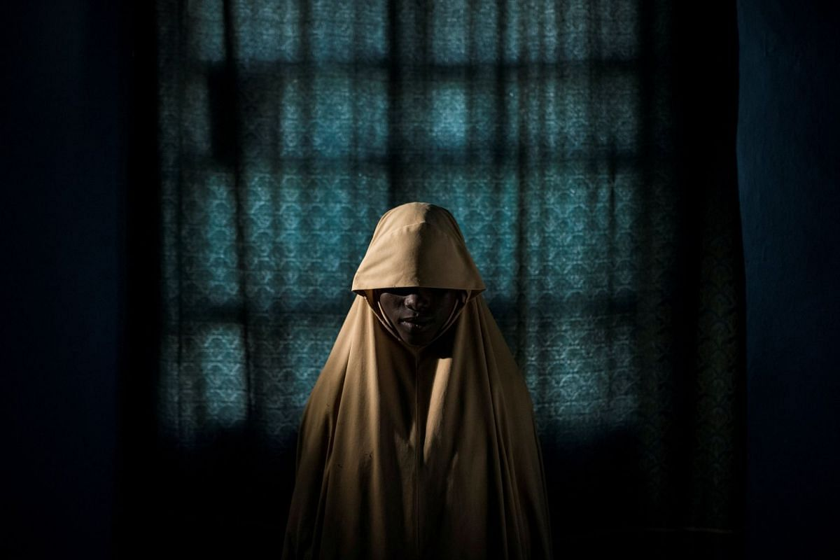 Nominated for the Picture of the Year and People-Singles in World Press Photo 2018, the photo shows 14-year-old Aisha standing for a portrait in Maiduguri, Borno State, Nigeria.