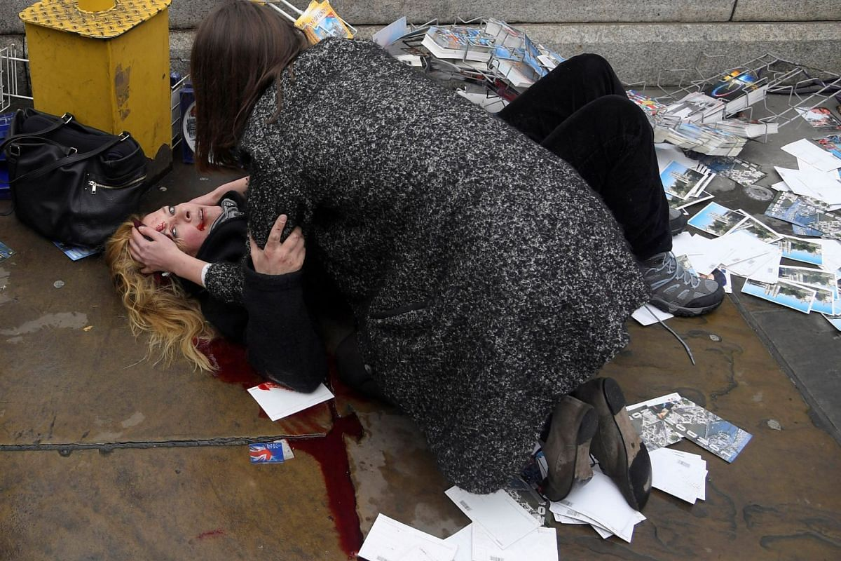 Nominated for Photo of the Year in World Press Photo 2018, the photo shows a passerby comforting an injured woman lying on the pavement after Khalid Masood drove his car into pedestrians, killing four in addition to a police officer at Westminster Br