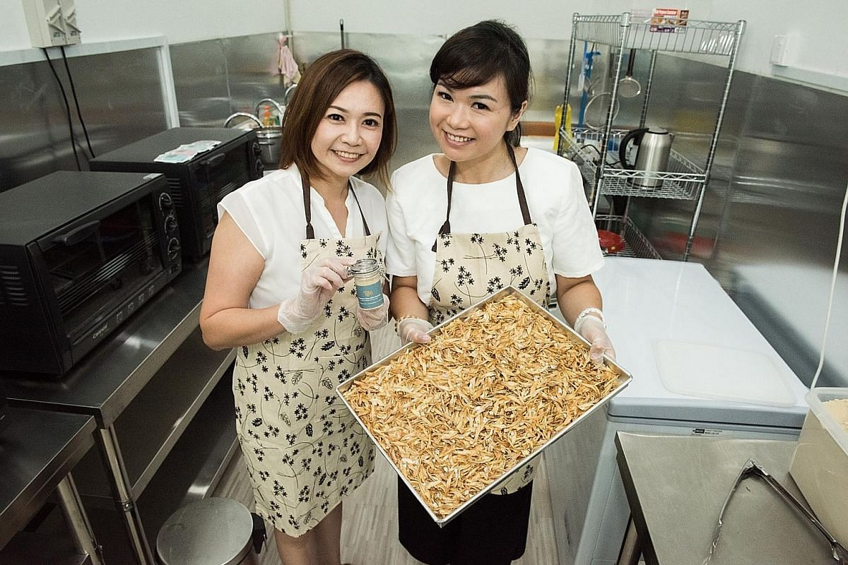 SG Homemade's Stephanie Goh (above, with her daughter Sarah Tan, 21/2), bakes ingredients such as kelp and chicken before dehydrating and grinding them into seasoning powders.