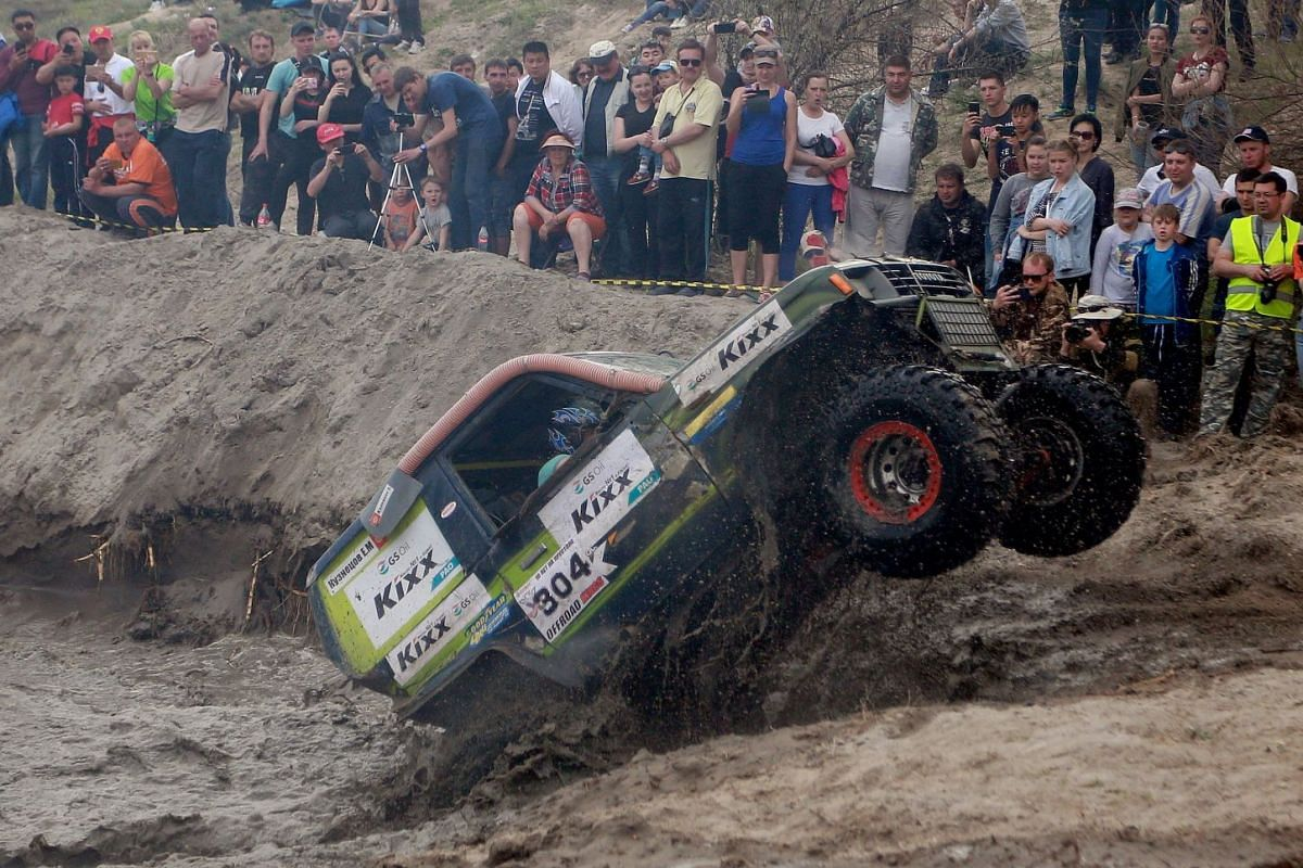 All-Terrain Vehicle (ATV) car drivers try to get through a mud pit during the Jeep Sprint Festival of the off-roader club 'Offroad Kings' in the village of Ozernoe, some 35 kilometers from Bishkek, Kyrgyzstan, 15 April 2018. PHOTO: EPA-EFE