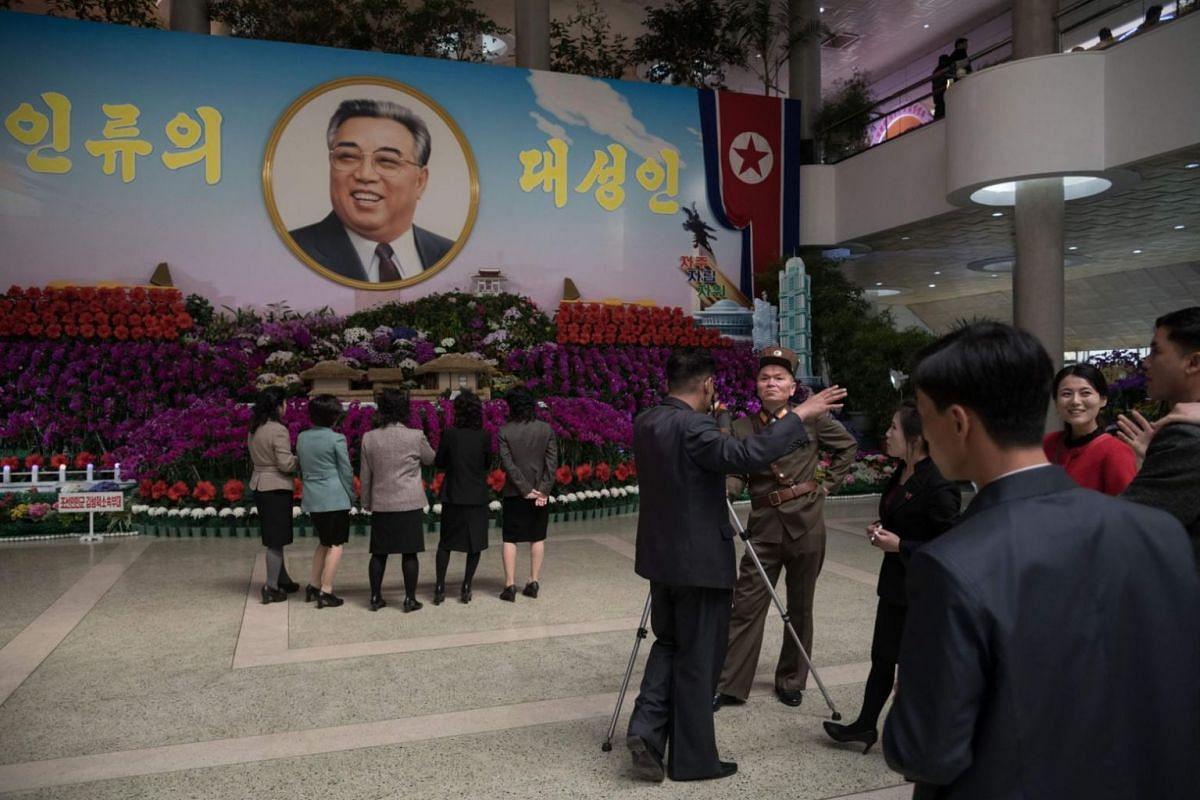 Visitors at the 20th Kimilsungia festival flower show in Pyongyang on April 13, 2018.
