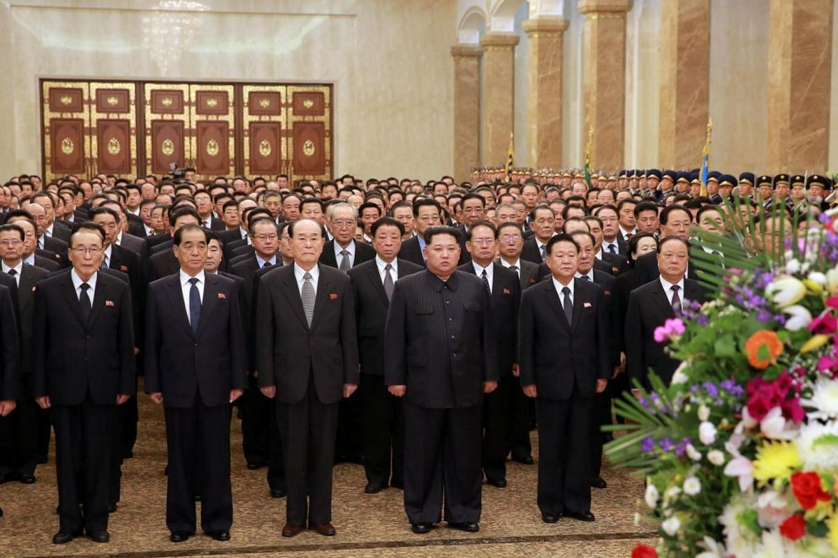 Kim Jong Un (centre) and his entourage visiting the Kumsusan Palace of the Sun to pay tribute to Kim Il Sung and Kim Jong Il in Pyongyang, North Korea, on April 15, 2018.