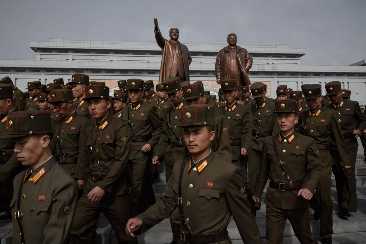 Korean People's Army soldiers leave after paying their respects before the statues of late North Korean leaders Kim Il Sung and Kim Jong Il, at Mansu Hill in Pyongyang.