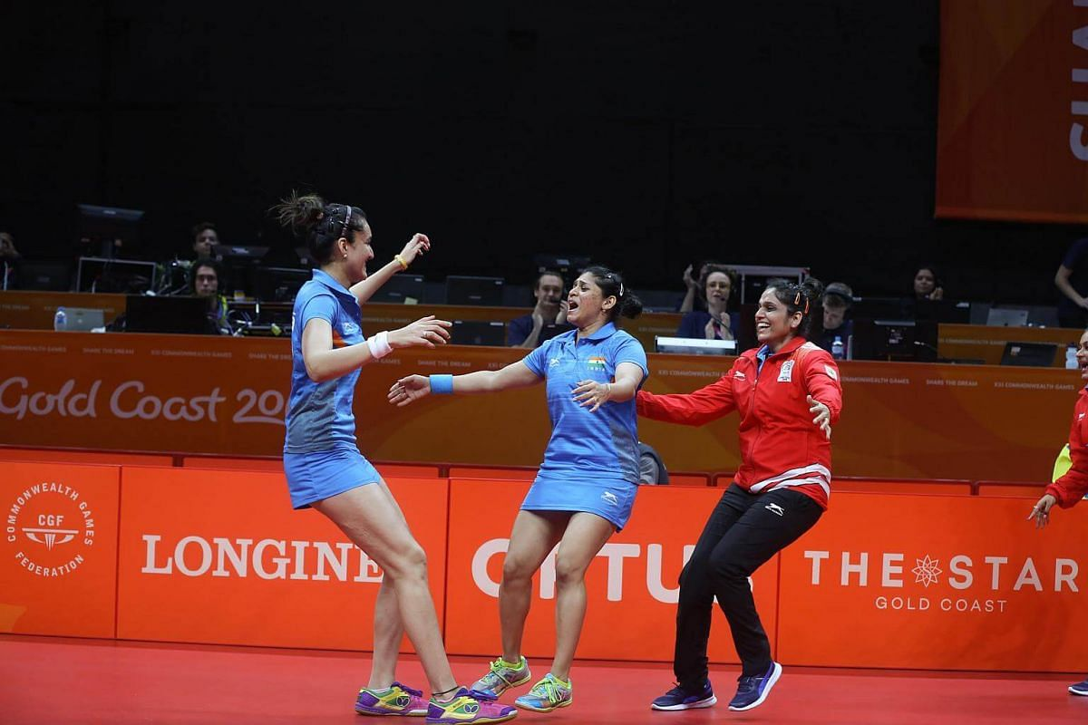 India's table tennis team celebrate their gold medal win against Singapore women's table tennis team at the Gold Coast Commonwealth Games 2018 in Australia, on April 8, 2018.
