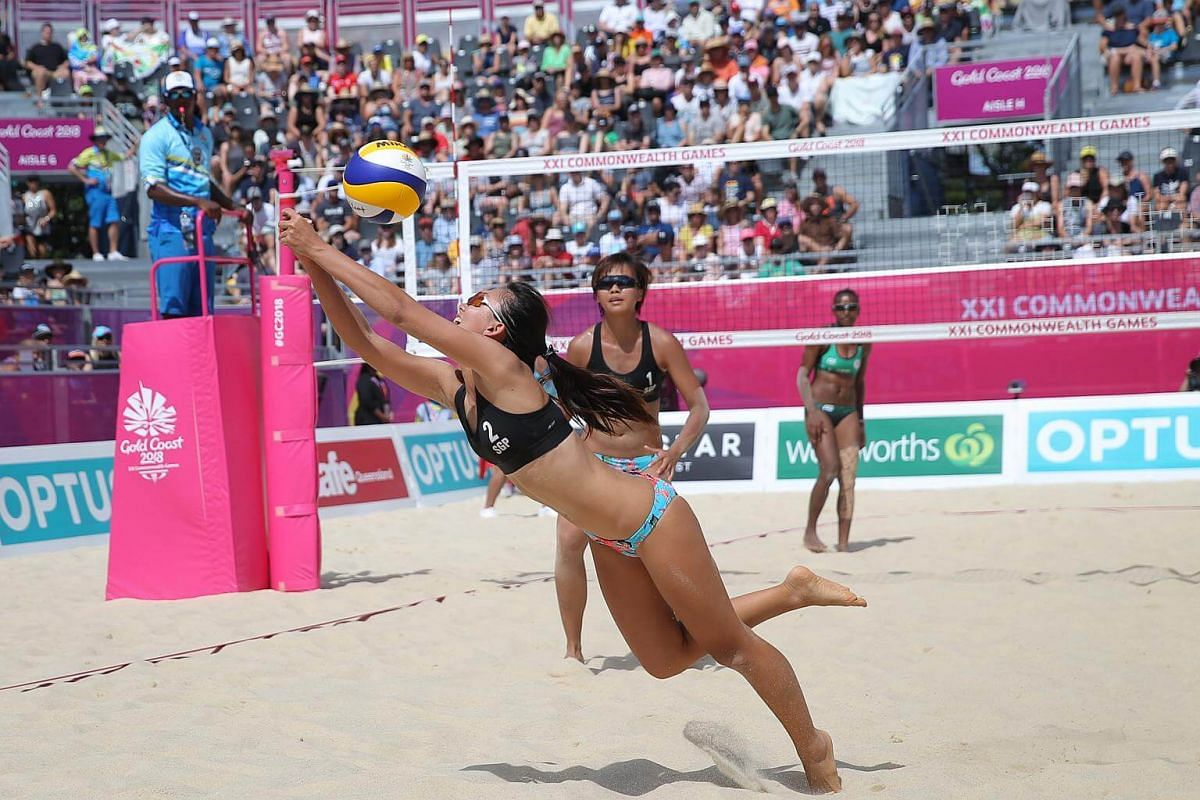 Singapore's Ong Wei Yu scrambling to save a spike as partner Lau Ee Shan looks on during their Pool C opener at the Commonwealth Games 2018, on the Coolangatta beachfront, on April 7, 2018.