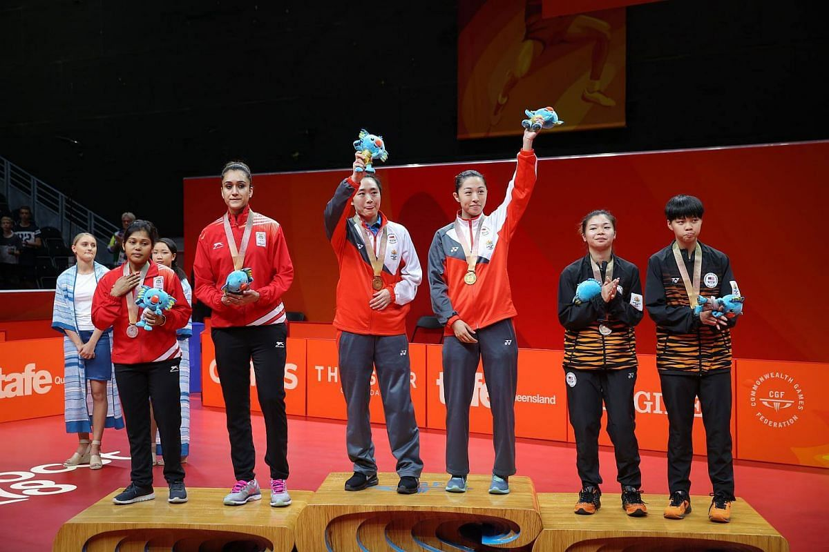 Singapore's Feng Tianwei and Yu Mengyu (center) won gold in the women's table tennis doubles finals at the Gold Coast Commonwealth Games 2018 in Australia, on April 13, 2018.