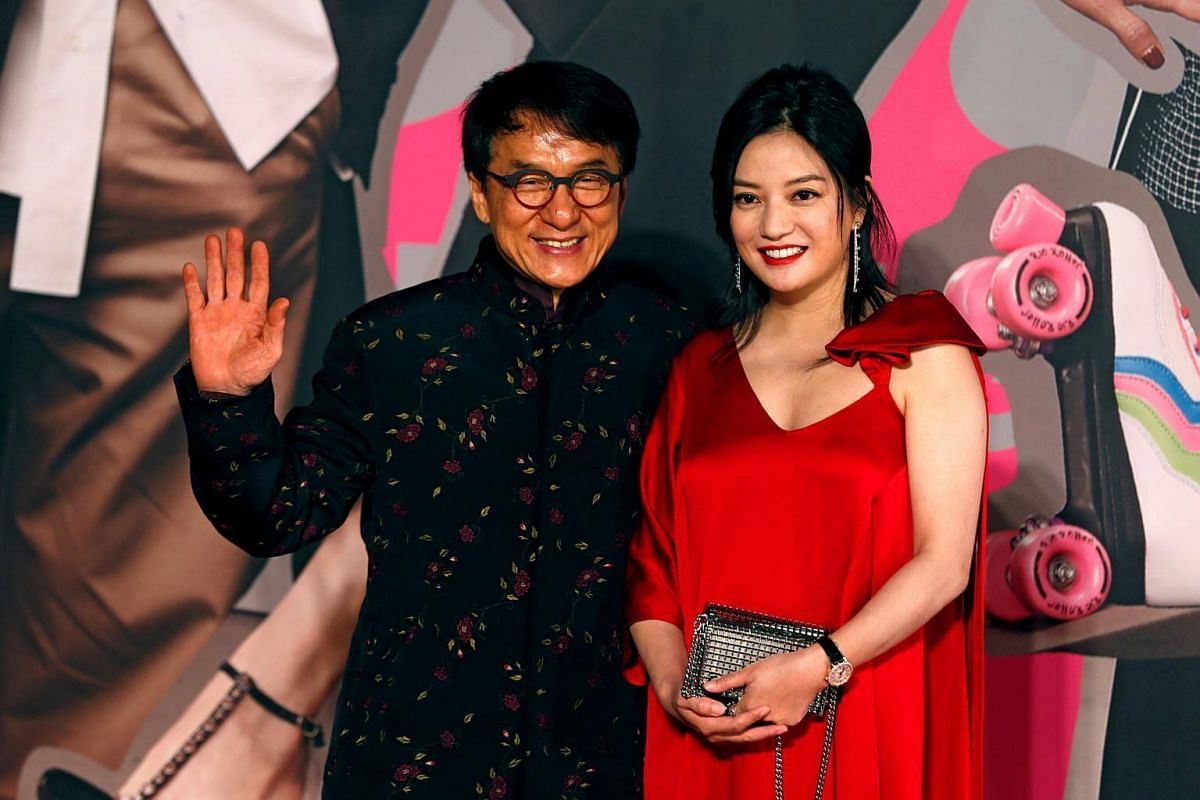 Hong Kong actor Jackie Chan and Chinese actress Zhao Wei posing on the red carpet.