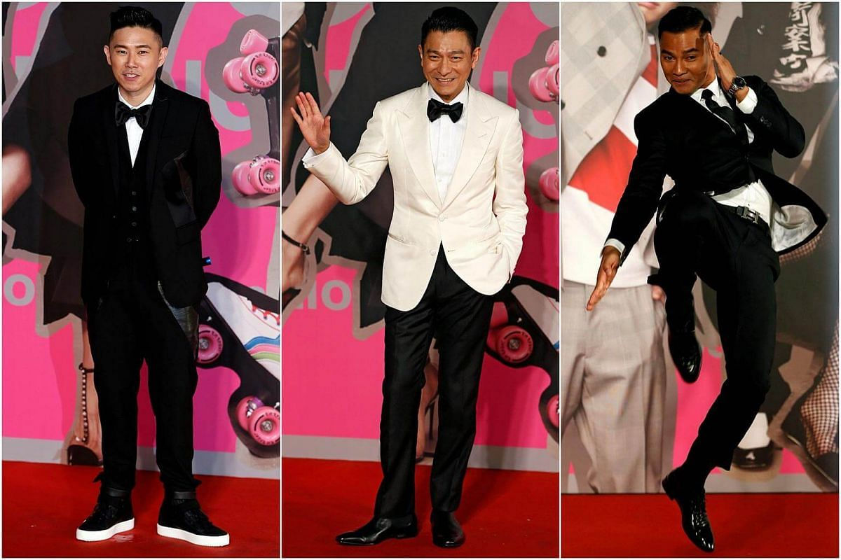 (From left) Hong Kong-American rapper MC Jin, Hong Kong actor Andy Lau and Thai actor Tony Jaa posing for photos on the red carpet of the 37th Hong Kong Film Awards.