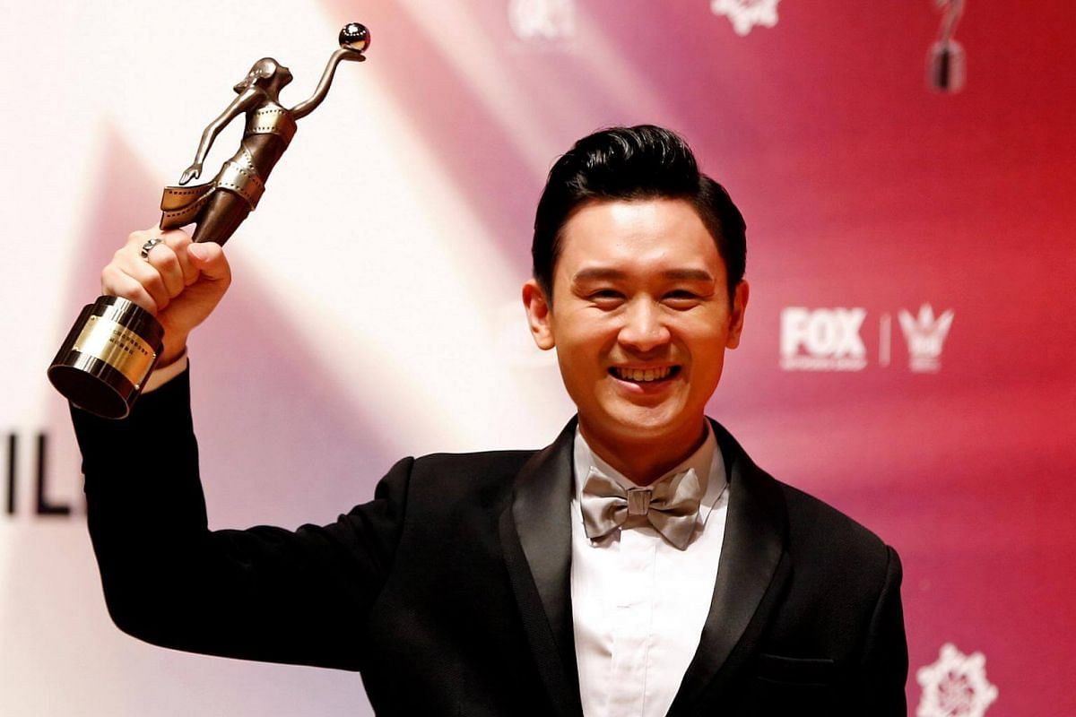 Hong Kong actor Ling Man Lung, who won the Best New Performer award, posing with his trophy.