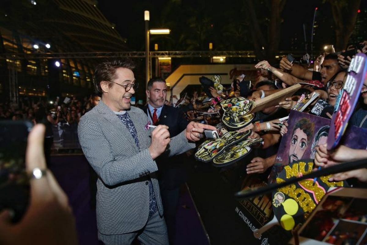 Actor Robert Downey Jr, who plays Iron Man, signing autographs for fans at the Marvel Studios' Avengers: Infinity War fan event at the Marina Bay Sands Event Plaza, 16 April 2018. PHOTO: THE STRAITS TIMES/KEVIN LIM