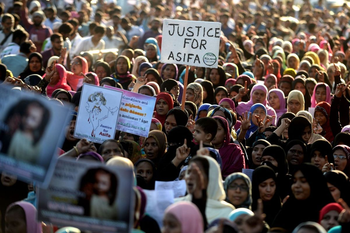 Indian Muslim women hold placards and shout slogans during a protest against the recent rape and murder case of an eight-year-old girl in the Indian state of Jammu and Kashmir, in Chennai on April 16, 2018. PHOTO: AFP