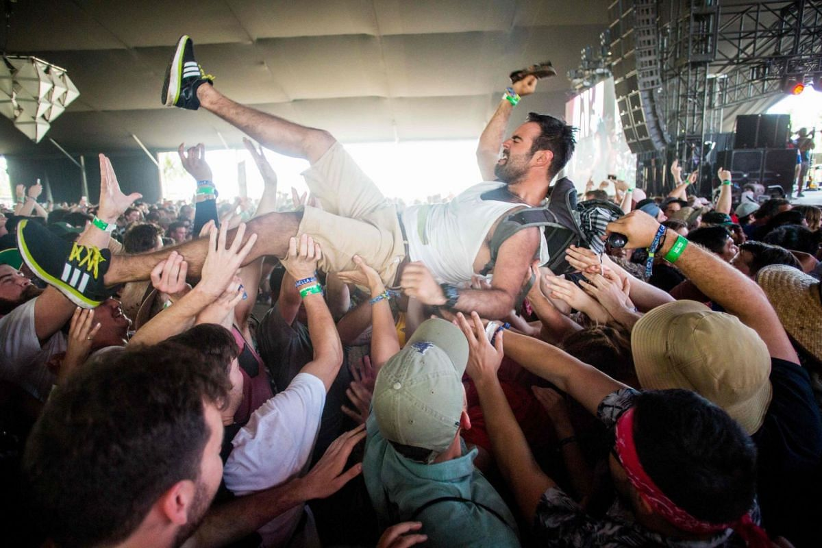 A fan crowd surfs as Fidlar performs at the Coachella Music and Arts Festival in Indio, California on April 15, 2018. PHOTO: AFP