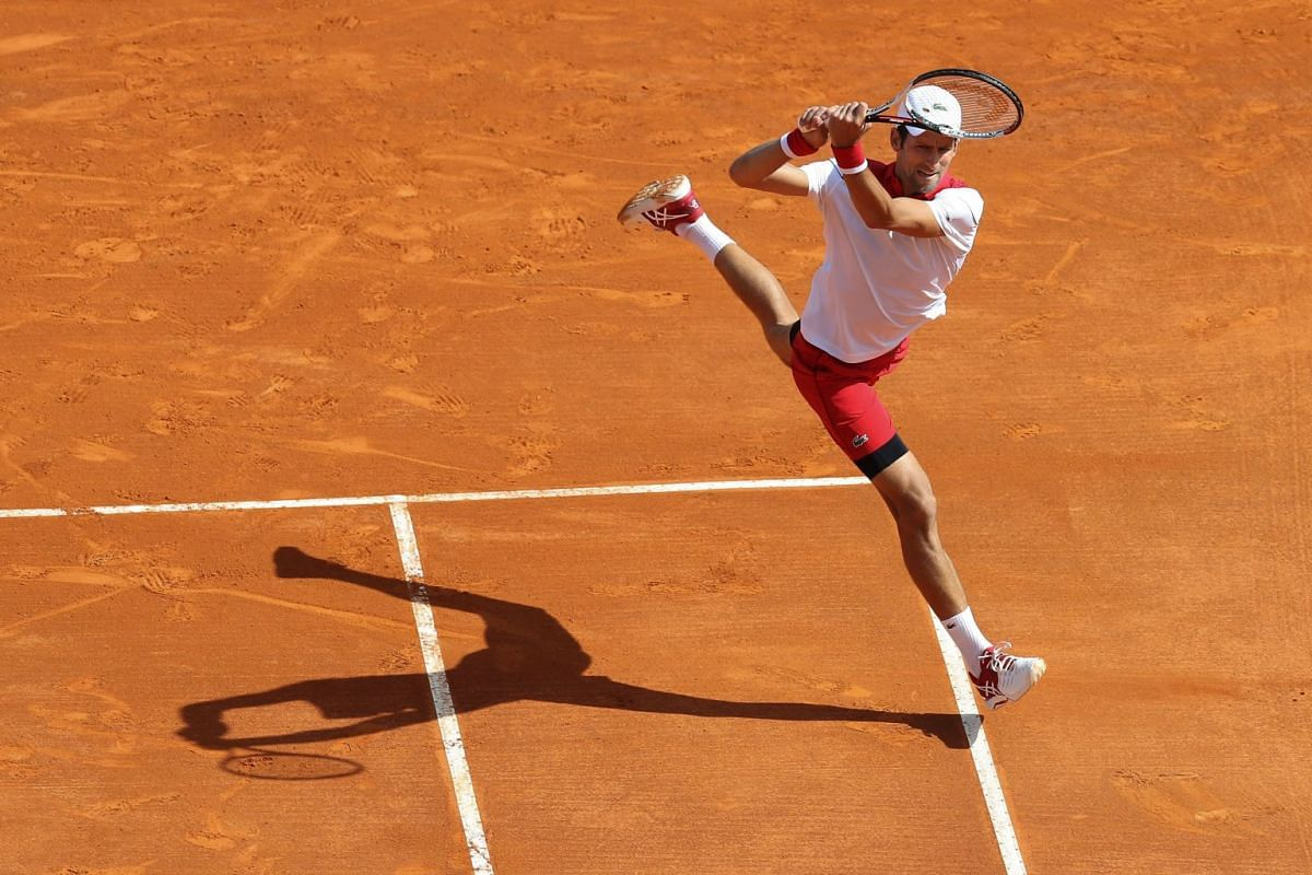 Serbia's Novak Djokovic returns a ball to compatriot Dusan Lajovic during their round of 64 tennis match at the Monte-Carlo ATP Masters Series Tournament, on April 16, 2018 in Monaco. PHOTO: AFP