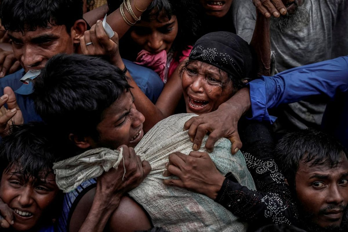 Rohingya refugees scramble for aid at a camp in Cox's Bazar, Bangladesh, on Sept 24, 2017.