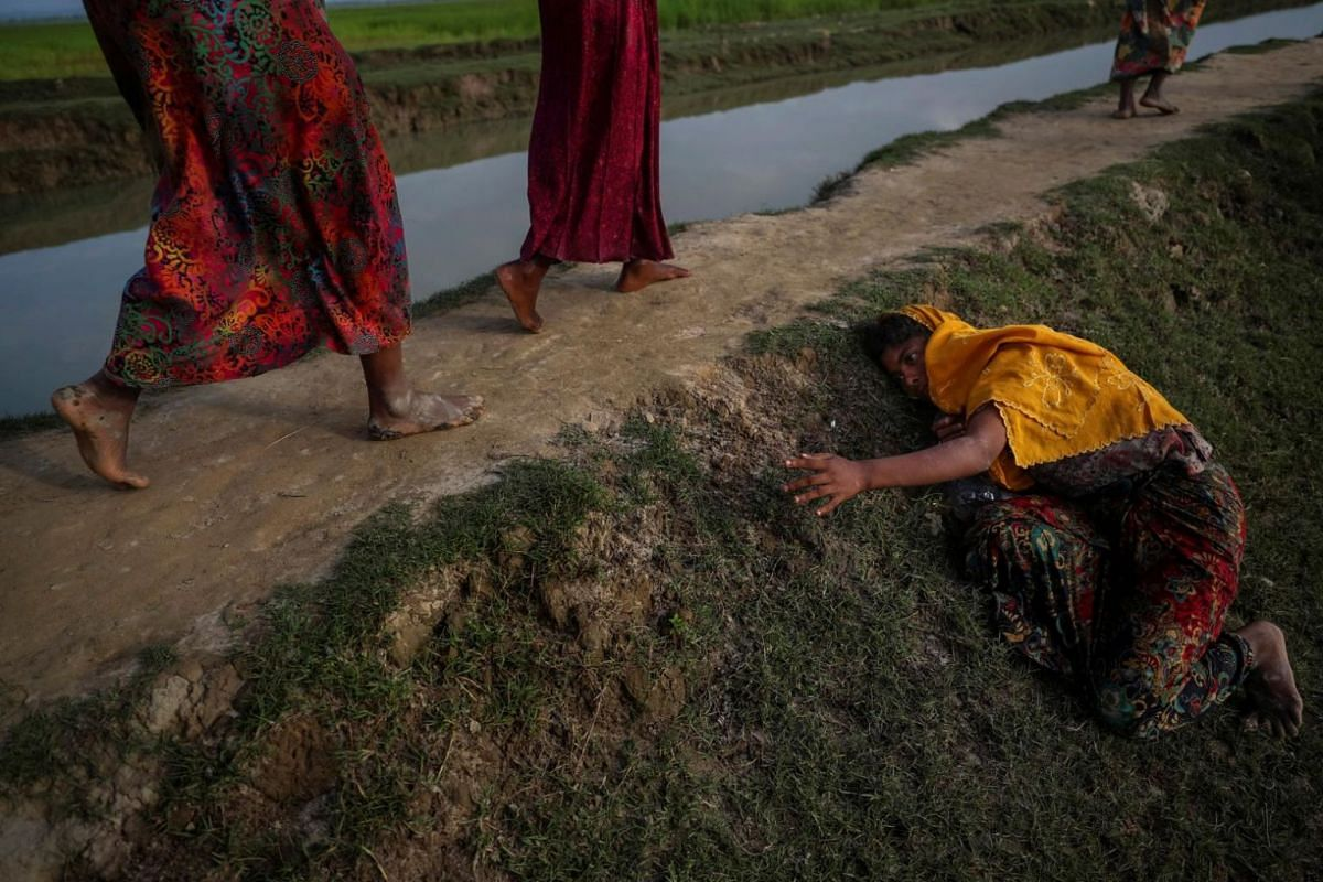 An exhausted Rohingya refugee fleeing violence in Myanmar cries for help from others crossing into Palang Khali, near Cox's Bazar, Bangladesh, on Nov 2, 2017.