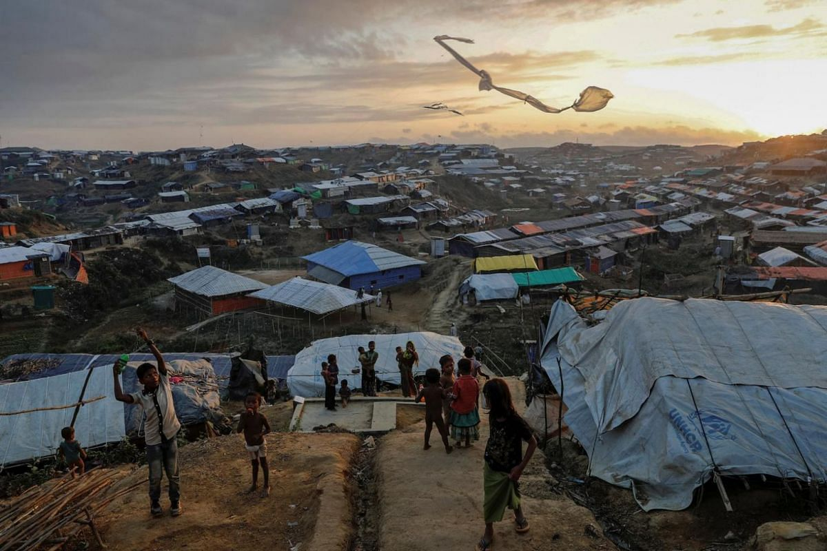 Rohingya refugee children fly improvised kites at the Kutupalong refugee camp near Cox's Bazar, Bangladesh, on  Dec 10, 2017.