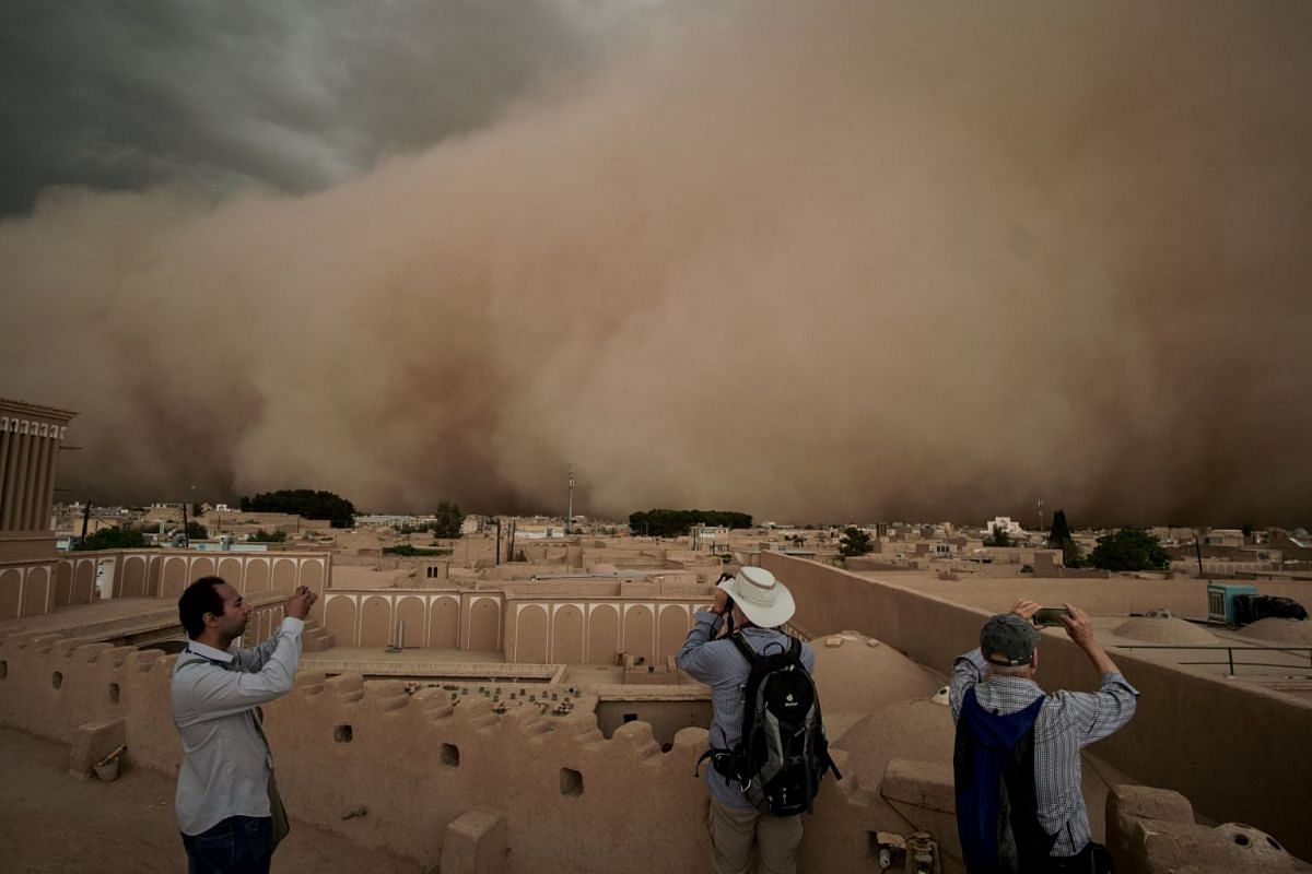 People take pictures of a sandstorm in Yazd, Iran April 16, 2018 in this image obtained from social media. PHOTO: MATTHIAS SCHMIDT VIA REUTERS
