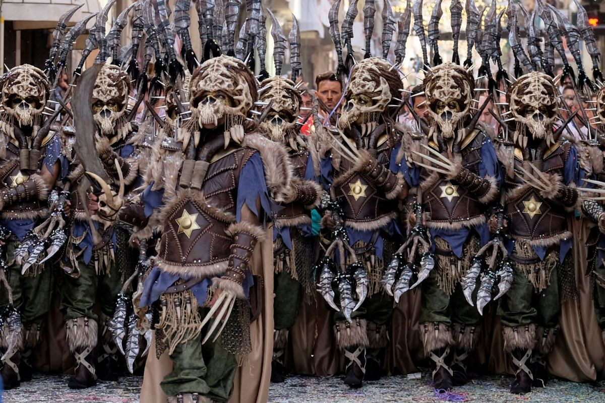 Revellers decked out in costumes at the annual Moors and Christians festival, which pays tribute to the Moorish and Christian soldier confrontation in the 13th century, parade through Alcoy, Spain April 22, 2018.