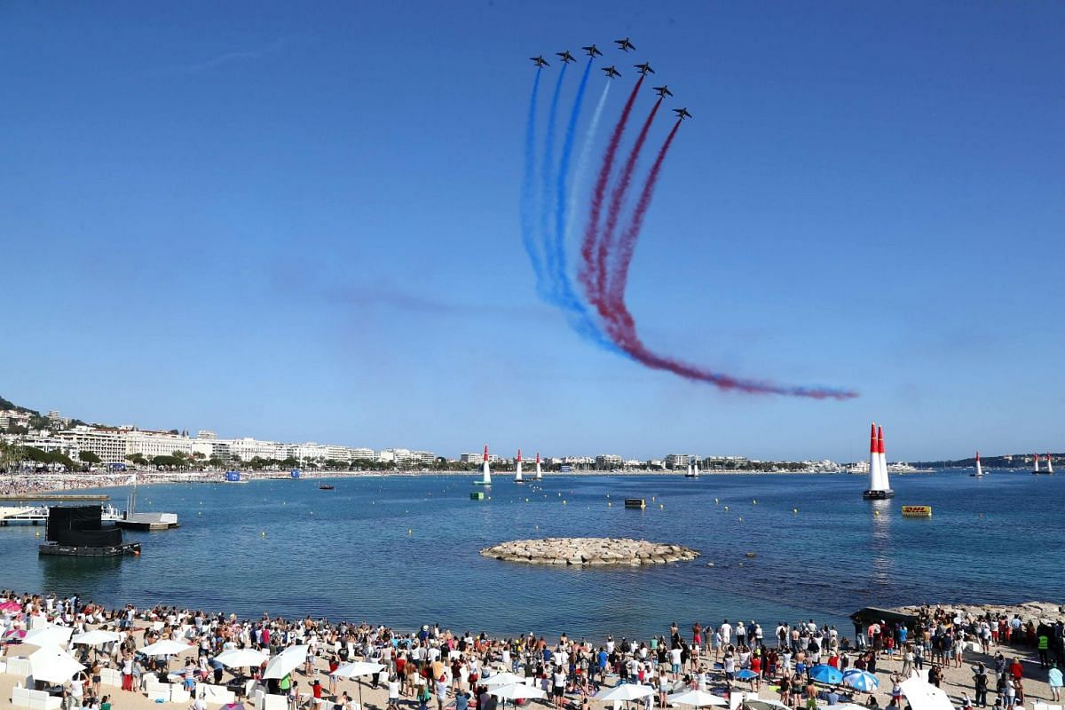 The French national air display team, Patrouille de France, performs during the 2018 Red Bull Air Race World Championship on April 22, 2018 in Cannes, southern France.