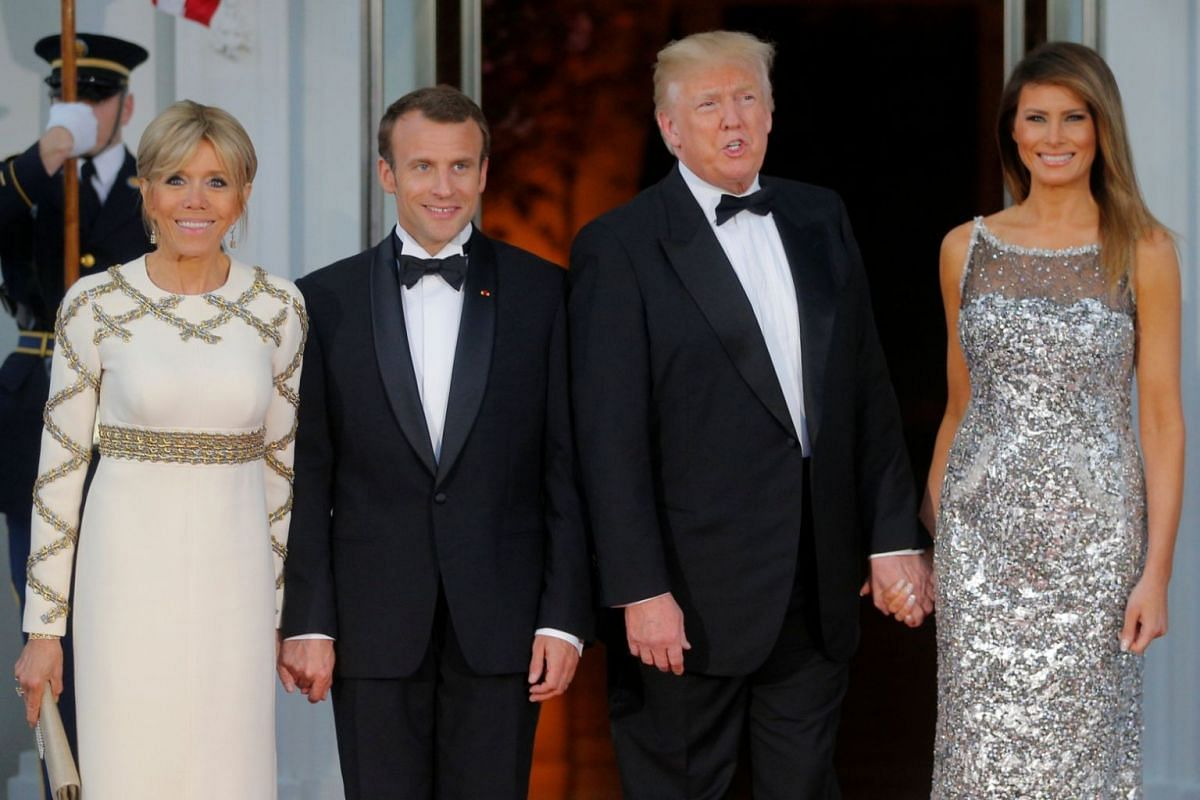 US President Donald Trump (second from right) and first lady Melania Trump (right) welcoming French President Emmanuel Macron and his wife Brigitte for a State Dinner at the White House in Washington, on April 24, 2018.