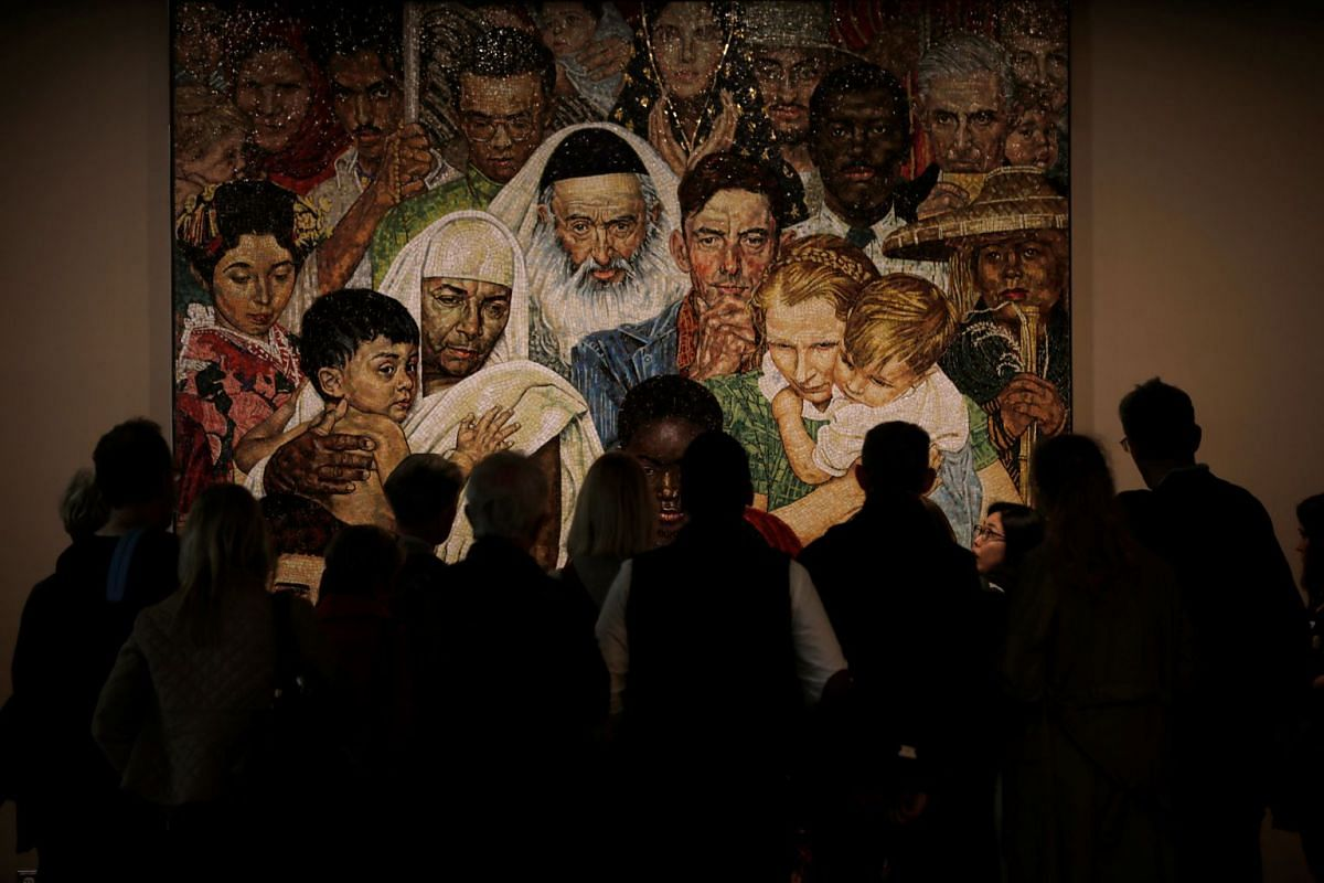 A tour group looks at 'The Golden Rule Mosaic', a work based on a painting by Norman Rockwell as they visit the United Nations Headquarters in New York City, New York, U.S., April 24, 2018.