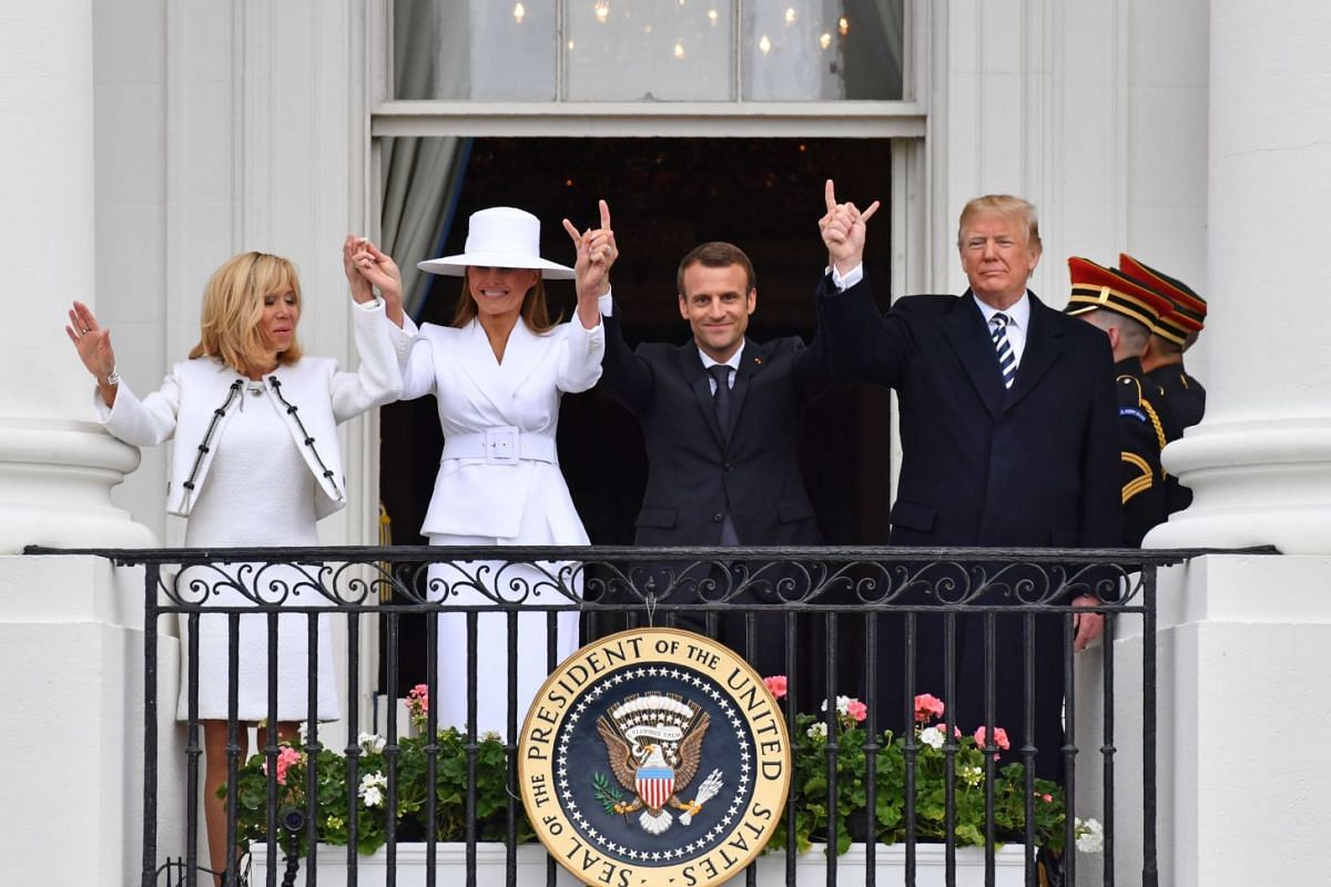 US President Donald Trump (right), French President Emmanuel Macron (second from right), US First Lady Melania Trump (second from left) and French First Lady Brigitte Macron are seen on the balcony at the White House in Washington, DC, U.S. on April